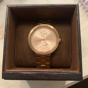 Authentic Rose Gold Micheal Kors watch